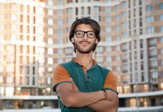 Portrait of a young muslim man with glasses. Portrait of a young muslim man with glasses on the background of the city street stock image