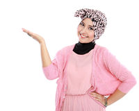 Portrait of a young muslim woman showing blank area Royalty Free Stock Photos