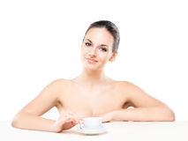 Portrait of a young and naked Caucasian woman with a cup of coffee Stock Photo