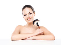 Portrait of a young and naked Caucasian woman with a makeup brush Royalty Free Stock Images