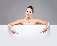 Portrait of a young and naked Caucasian woman with a necklace Royalty Free Stock Photo