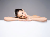 Portrait of a young and naked Caucasian woman with a white banner Stock Photo