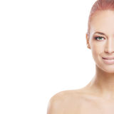 Portrait of a young naked redhead woman. Portrait of a young and naked redhead Caucasian woman in a beautiful makeup. The image is isolated on a white background Stock Images