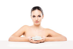 Portrait of a young naked woman holding pearls Stock Photography
