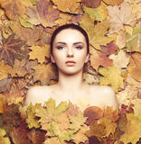 Portrait of young, natural and healthy woman over autumn backgro. Und. Healthcare, spa, makeup and face lifting concept Stock Images