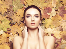 Portrait of young, natural and healthy woman over autumn backgro. Und. Healthcare, spa, makeup and face lifting concept Stock Photography