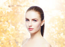 Portrait of young, natural and healthy woman over yellow autumn background. Healthcare, spa, makeup and face lifting concept Royalty Free Stock Photos