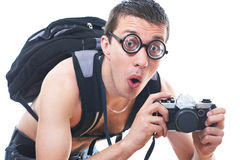 Portrait of a young nerd with old fashioned camera Royalty Free Stock Image