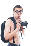 Portrait of a young nerd with old fashioned camera Royalty Free Stock Images