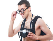 Portrait of a young nerd with old fashioned camera Stock Images