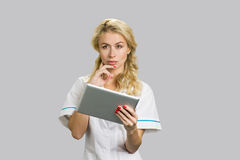 Portrait of young nurse with digital tablet. Stock Photo