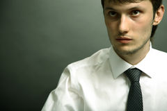 Portrait of young office manager. Portrait of young office manager on black background. Studio photo Royalty Free Stock Image