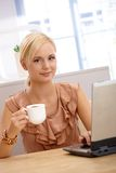 Portrait of young office worker on coffee break Stock Photo