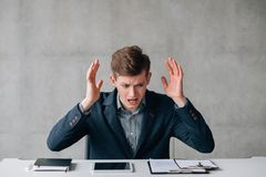 Pissed off young office worker dealing problems stock photos