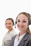 Portrait of young operators using headsets Stock Images