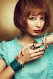 Portrait of young orient girl with fashionable accessories Stock Photos