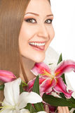 Woman xxl lilies smiling tongue Stock Photo