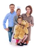 Portrait of young parents who will soon bring. Happy childhood, the family concept.Portrait of young parents who will soon bring their children to school Royalty Free Stock Images