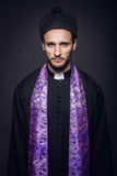Portrait of young pastor. Studio portrait on black background Stock Photography