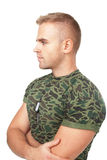 Portrait of young pensive army soldier. With his arms crossed isolated on white background stock photography