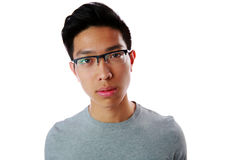 Portrait of a young pensive asian man Royalty Free Stock Photography