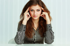 Portrait of a young pensive businesswoman sitting at the table Royalty Free Stock Photography