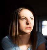 Portrait of a young pensively woman in home. Royalty Free Stock Photography