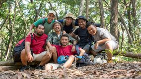 Asian friend smiling to camera after hiking. Portrait of young people in the forest together enjoying their time after hiking Royalty Free Stock Images