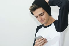 Portrait of young with the phone. Mobile in style modern Stock Image
