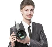 Portrait of young photographer with camera on white background royalty free stock photography