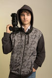 Portrait of a young photographer with a professional camera Royalty Free Stock Image