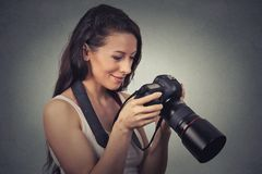 Portrait young photographer using reflex camera Stock Photo
