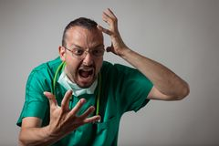 Portrait of a young physician shouting Stock Photo