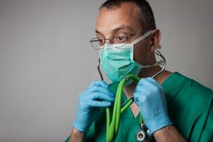 Portrait of a young physician with surgical mask Stock Images