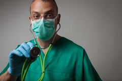 Portrait of a young physician using stethoscope Stock Photo
