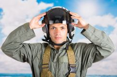 Portrait of young pilot wearing helmet with a sky Stock Photos
