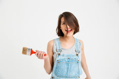 Portrait of young playful crazy beautiful girl, holding paint brush Stock Photography