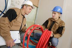 Portrait young plumber Stock Photography