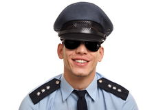 Portrait of young policeman. Portrait of smiling policeman in sunglasses on white background stock image