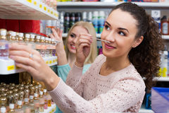 Portrait of young positive female customers. Shopping in beauty store Stock Photos