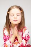 Portrait of young praying girl Royalty Free Stock Photos