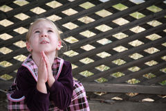 Portrait of young praying girl Stock Photography