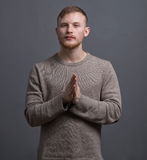 Portrait of young praying man Stock Photo