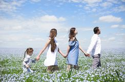 Portrait of a young pregnant family in linen field royalty free stock photography
