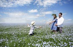 Portrait of a young pregnant family in linen field Royalty Free Stock Image