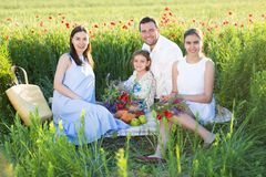 Portrait of a young pregnant family in poppy field Stock Photography