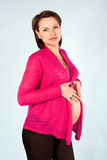Portrait of the young pregnant woman. Studio shoot Stock Photo