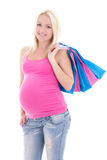 Portrait of young pregnant woman with shopping bags isolated on. Portrait of young attractive pregnant woman with shopping bags isolated on white background Stock Image