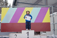 Portrait of young preschool boy, with medal for ending a ski sch Royalty Free Stock Photography