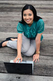 Portrait young pretty Asian muslim college girl with laptop and smile Stock Image